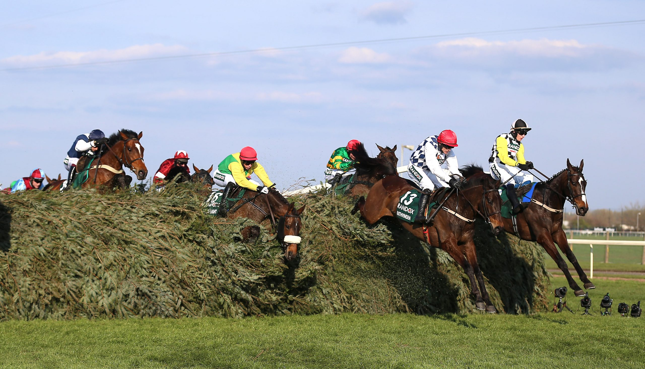Horses jump a fence during the 2019 Grand National