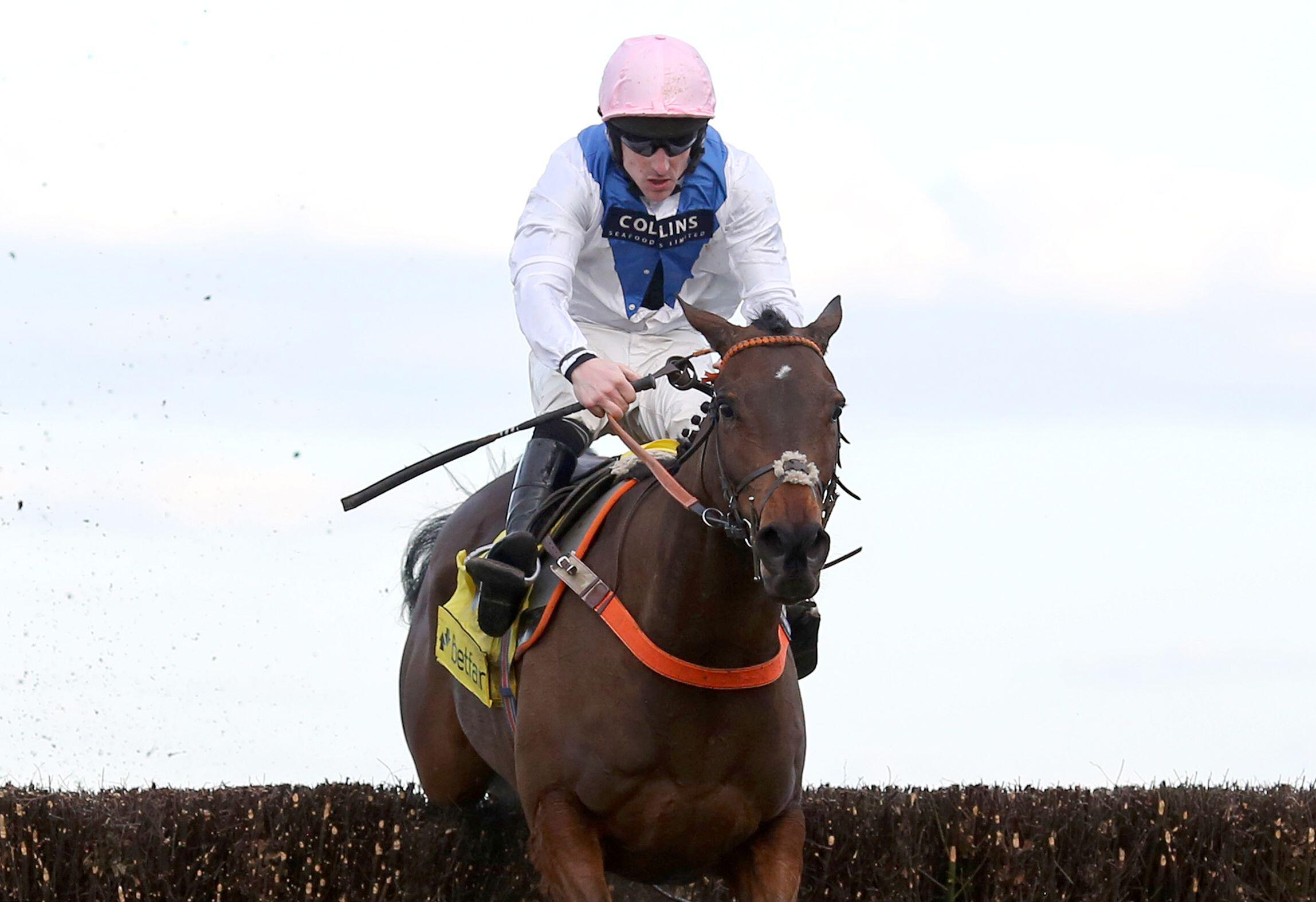 Brian Hughes riding Waiting Patiently to victory in the Grade 1 Ascot Chase in 2018