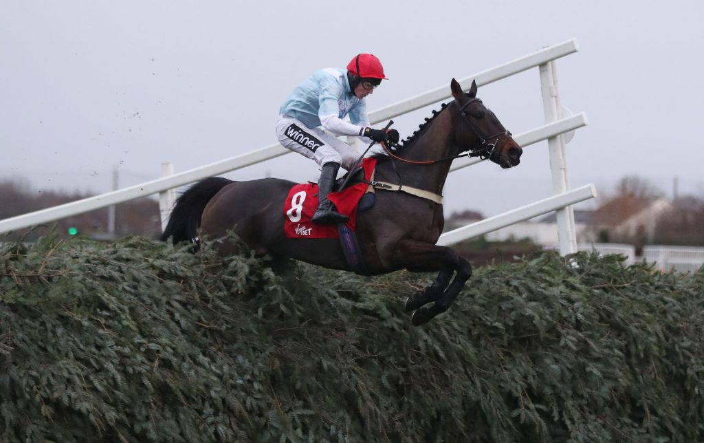 Hogan's Height ridden by Tom Cannon on their way to victory in the Virgin Bet Grand Sefton Handicap Chase during Becher Chase Raceday at Aintree Racecourse, Merseyside.