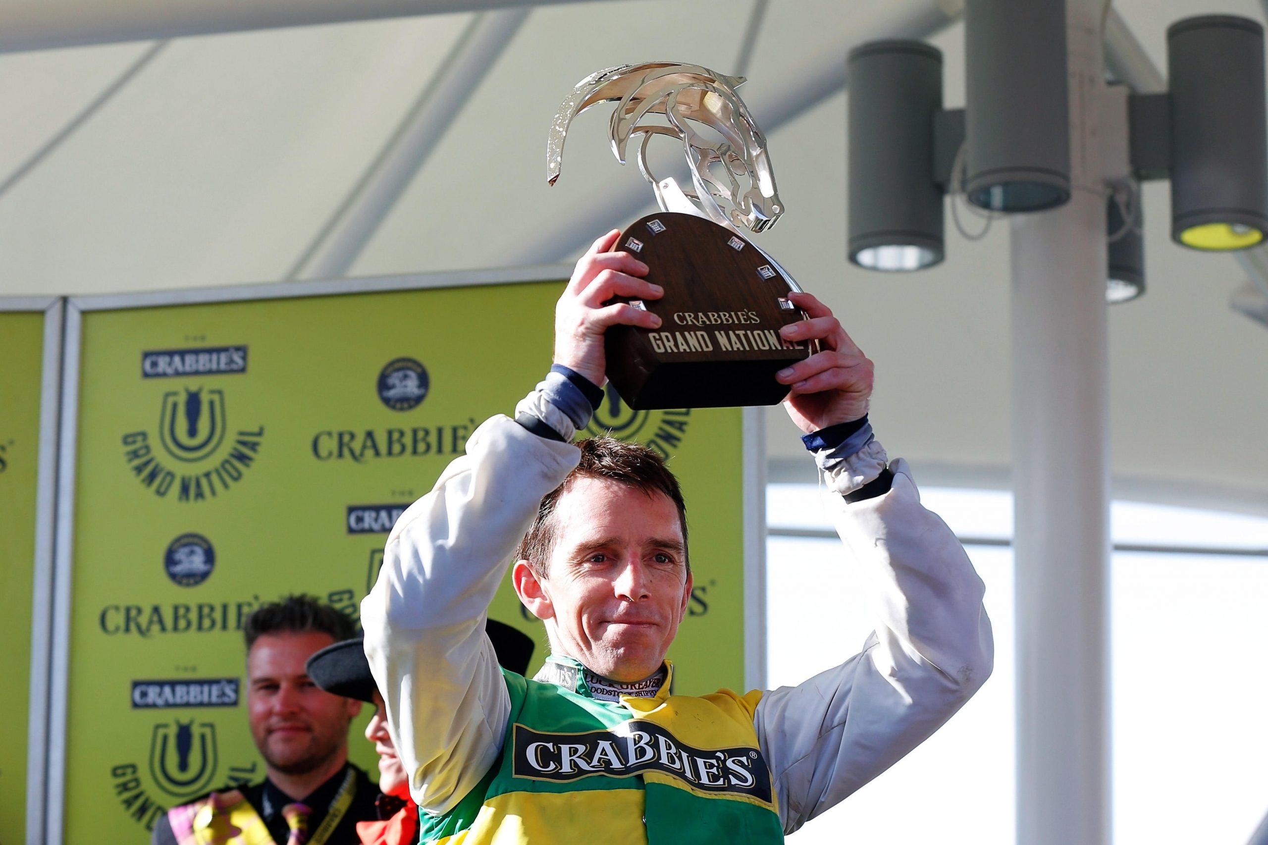 EKKDTD Aintree Racecourse, Liverpool, UK. 11th Apr, 2015. Crabbies Grand National. Winning jockey Leighton Aspell lifts the Grand National Trophy Credit: Action Plus Sports Images/Alamy Live News