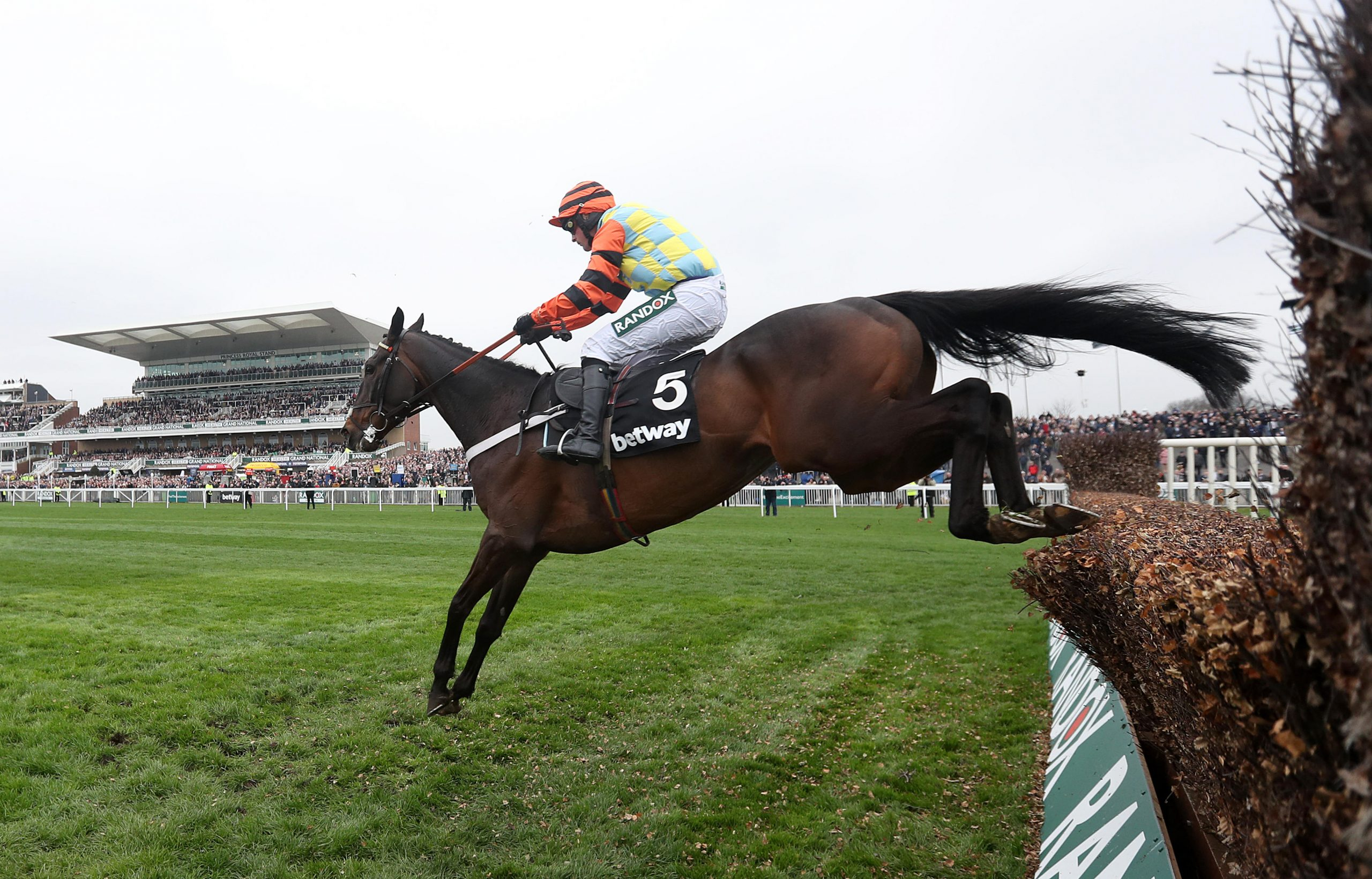 Might Bite ridden by Nico de Boinville jumps the last prior to winning the Betway Bowl Chase during day one of the 2018 Randox Health Grand National Festival at Aintree Racecourse, Liverpool.