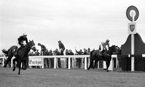 The thrilling finish of the Grand national Steeplechase at Aintree, with Red Rum, ridden by Brian Fletcher sweeping to the three-quarters length victory over Crisp, Richard Pitman (right), who had led nearly all the way.