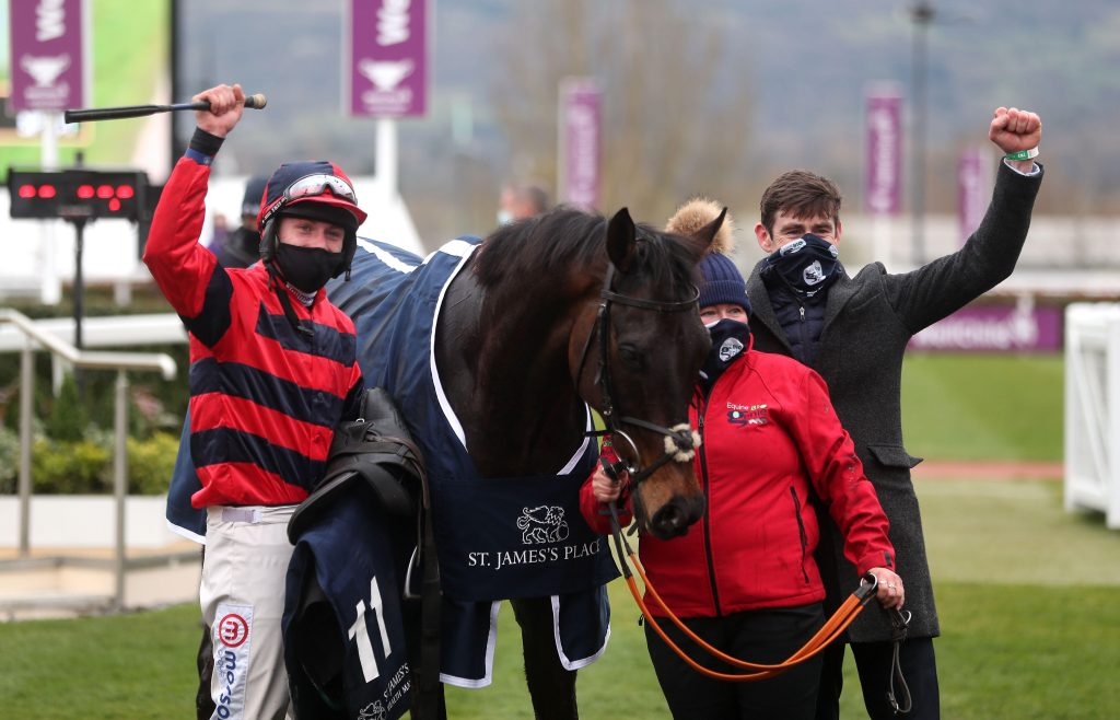 2F4854C Jockey Lorcan Williams and trainer Will Biddick celebrate winning the St. James's Place Festival Challenge Cup Open Hunters' Chase with Porlock Bay on day four of the Cheltenham Festival at Cheltenham Racecourse. Picture date: Friday March 19, 2021.
